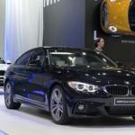 BMW Serie 4 Gran Coupé y el X6 al fondo