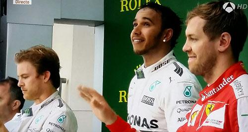 Podio de Austin, con Lewis Hamilton exultante, Sebastian Vettel feliz y Nico Rosberg cariacontecido  (Foto Antena 3 TV).